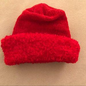 Red knit hat with fuzzy trim